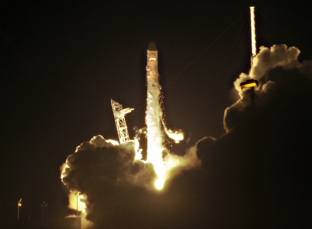 SpaceX's Falcon 9 rocket lifts off early May 22, 2012 as it heads for space carrying the company's Dragon spacecraft from pad 40 at Cape Canaveral, Florida. The Dragon capsule is scheduled to dock with the International Space Station in a few days.