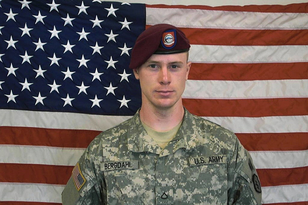 In this undated image provided by the U.S. Army, Sgt. Bowe Bergdahl poses in front of an American flag. Bergdahl, of Hailey, Idaho, walked off his post in Afghanistan on June 30, 2009, and was captured by the Taliban and held for nearly five years. He now faces charges of desertion and misbehavior before the enemy in a general court-martial.
