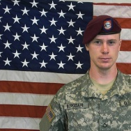 In this undated image provided by the U.S. Army, Sgt. Bowe Bergdahl poses in front of an American flag. U.S. officials say Bergdahl, the only American soldier held prisoner in Afghanistan, was exchanged for five Taliban commanders being held at Guantanamo Bay, Cuba, according to published reports. Bergdahl is in stable condition at a Berlin hospital, according to the reports.