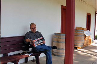 Kevin Roderick peruses his book The San Fernando Valley: America's Suburb , at Los Encinos State Historic Park.