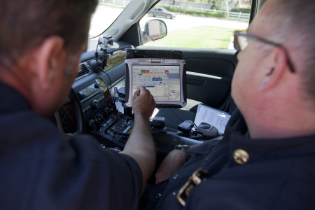 Rancho Cucamonga Fire Department Battalion Chief Ivan Rojer, left, and Deputy Chief Mike Costello demonstrate the geographic information system they use to track fire trucks and identify areas in the city with a high volume of calls for service.