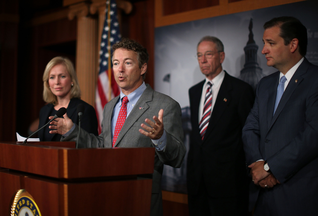 U.S. Sen. Rand Paul (R-KY) (C) speaks while flanked by U.S. Sen. Kirsten Gillibrand (D-NY) (L) U.S. Sen. Charles Grassley (R-IA) (2nd-R) and U.S. Sen. Ted Cruz (R-TX) (R)  during a news conference on sexual assault in the military, July 16, 2013 in Washington, DC. U.S. Sen. Gillibrand announced the support of 34 senators that will co-sponsor her proposal to take the decision whether to prosecute sexual assaults out of the hands of the military chain of command.