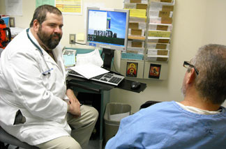 Doctors at California Medical Facility (CMF) in Vacaville, Calif., see inmates in a modern medical clinic.