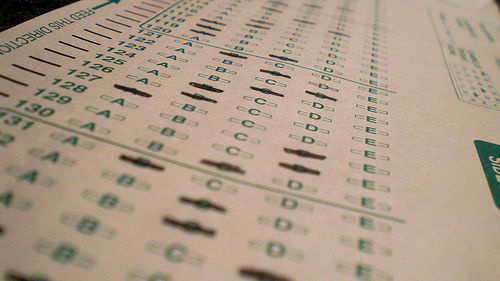 State education officials are worried about the hundreds of photos of standardized tests – sometimes with answers – that have begun to appear on social networking sites. A talk on whether to factor student test scores into teachers' performance evaluations is taking place on Monday afternoon.