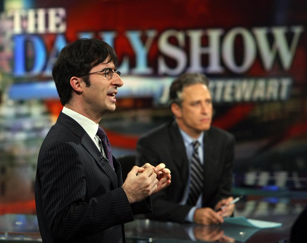 Correspondent John Oliver (L) and host Jon Stewarttape