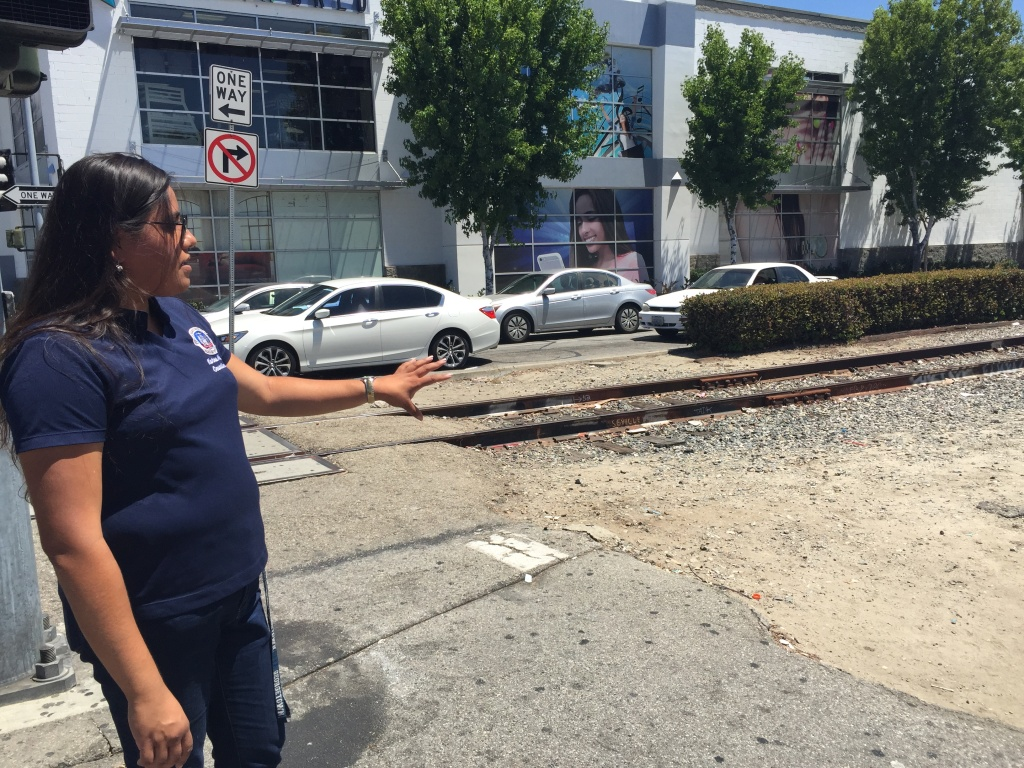 Huntington Park City Councilwoman Karina Macias points out the future site of a light rail station. Under Metro's ballot measure proposal, it would not be completed for at least 25 years.