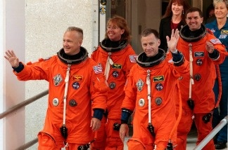 (L-R) Space shuttle Atlantis STS-135 pilot Douglas Hurley, mission specialist Sandra Magnus, commander Christopher Ferguson and mission specialist Rex Walheim walk out of the NASA Operations and Checkout building hours before their scheduled launch at Kennedy Space Center.
