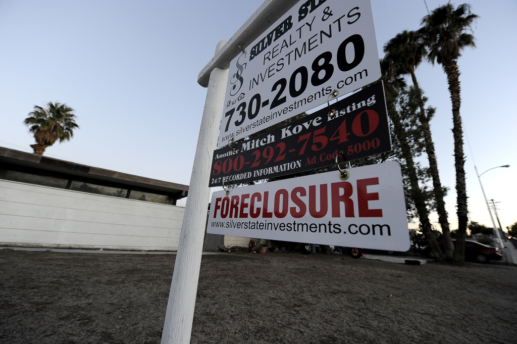 A foreclosure sign is seen in front of a bank-owned home for sale.