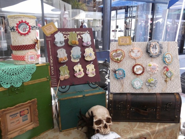 Skulls and brooches from repurposed book products at the Manda Landa booth at The Patchwork Indie Arts & Craft Festival.
