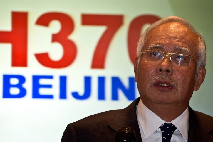 Malaysian Prime Minister Najib Razak addresses the media during a press conference at a hotel near Kuala Lumpur International Airport in Sepang on March 15, 2014. Najib Razak said that Malaysia was ending a search in the South China Sea for a vanished jetliner after investigations indicated the missing plane likely turned far to the west.