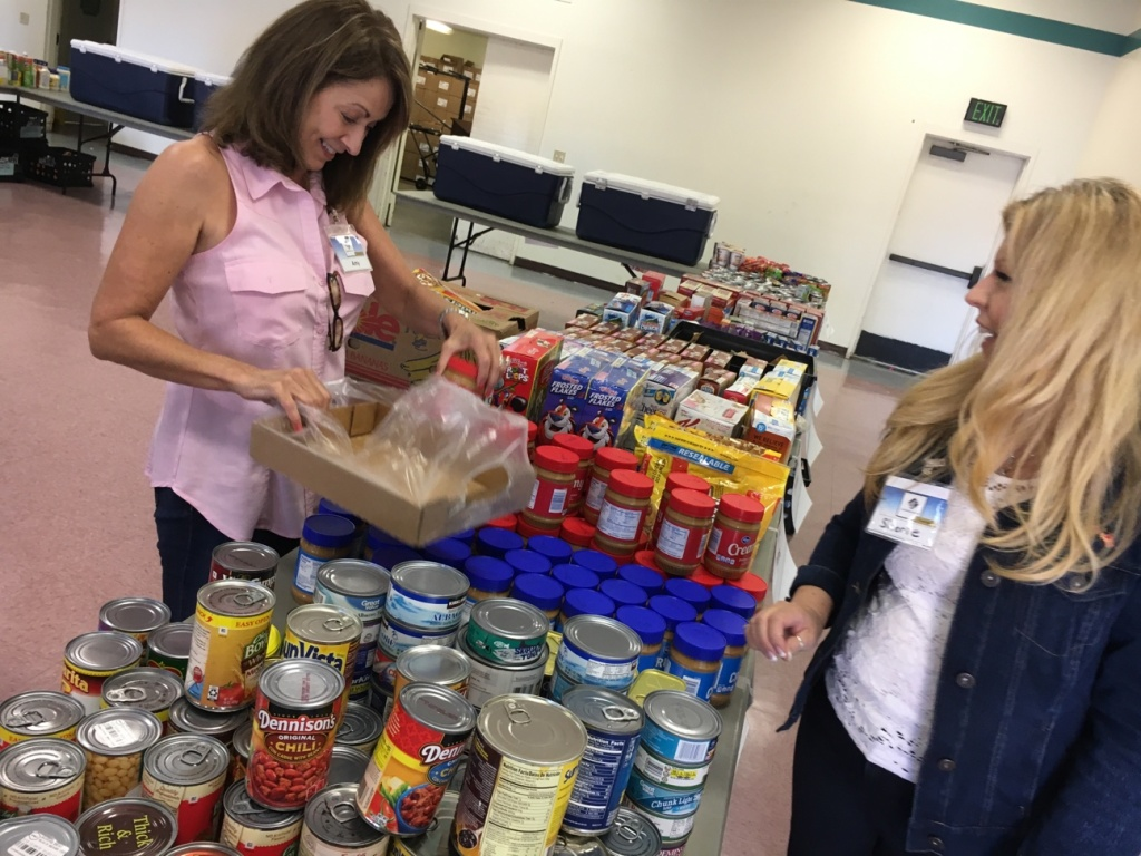 Volunteers with Saddleback Church set out donated food at Camp Pendleton's monthly food pantry. A Government Accountability Report found that the food pantry services at Pendleton were the most extensive of those at military bases and installations across the country.
