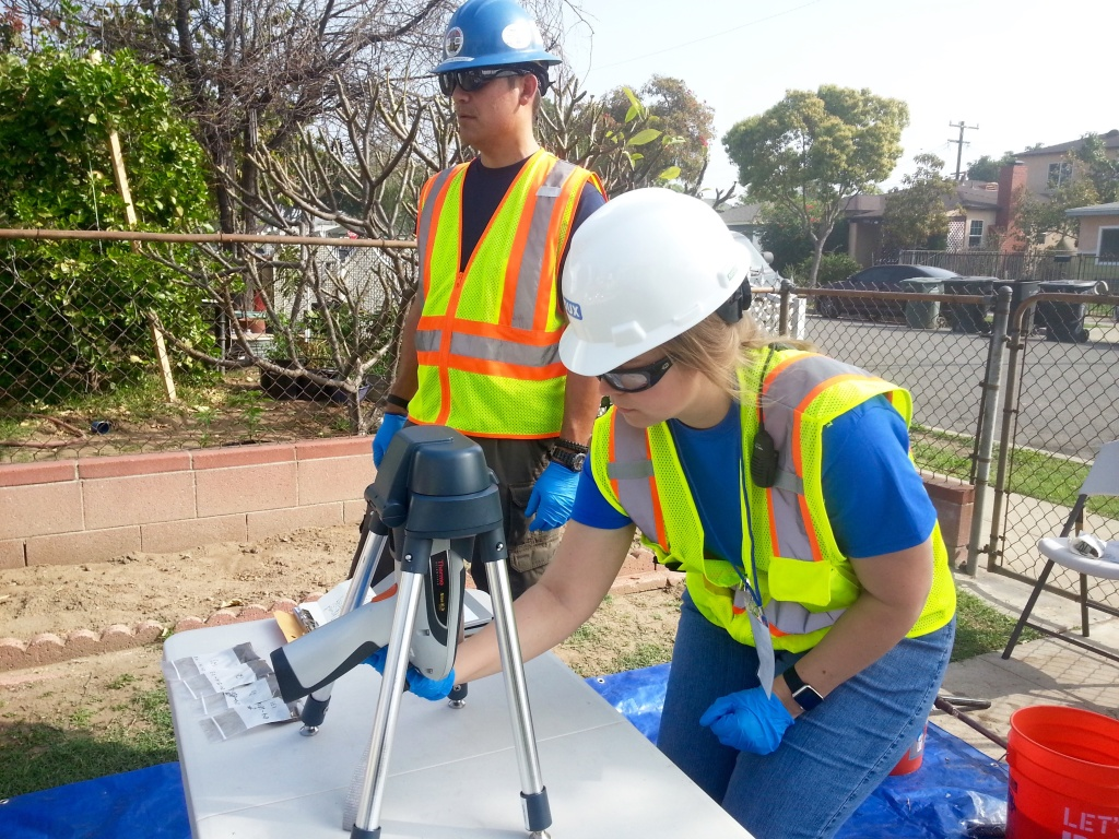 Members of an L.A. County Department of Public Health crew conduct a soil test on a property in Commerce, near the old Exide battery recycling plant.