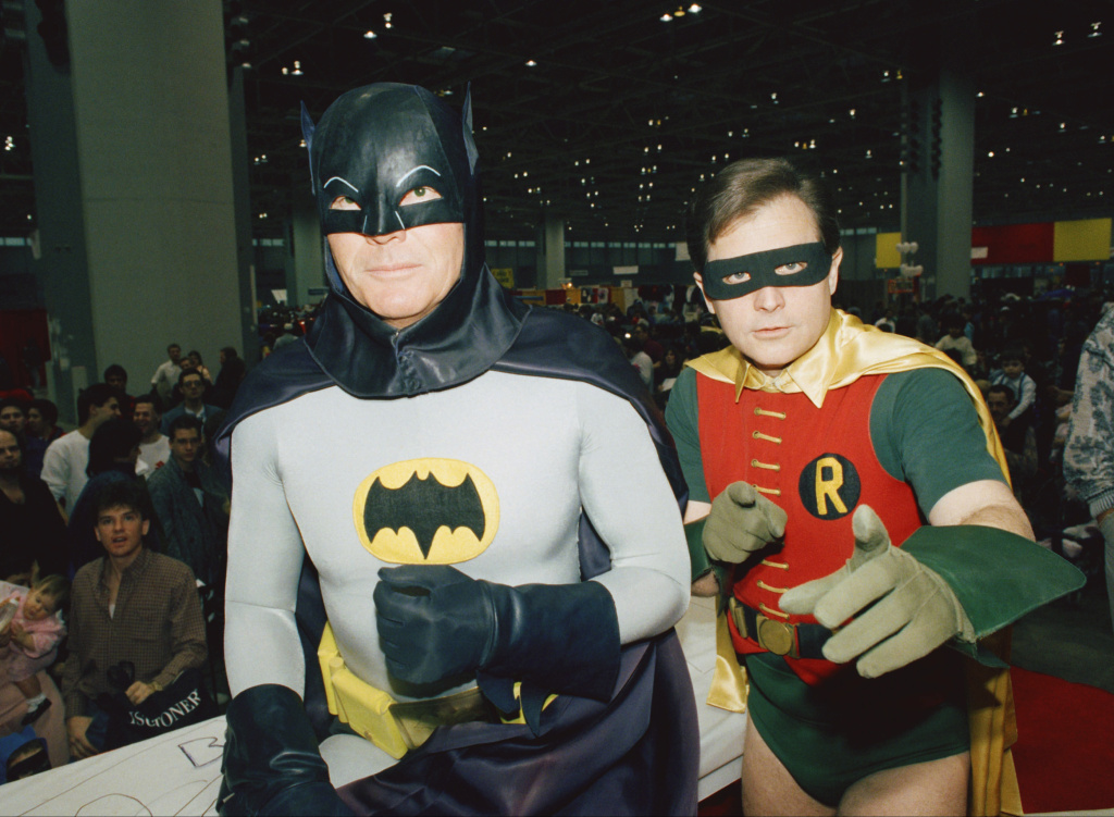 "Actors Adam West, left, and Burt Ward, dressed as their characters Batman and Robin, pose for a photo at the ""World of Wheels"" custom car show in Chicago in 1989."