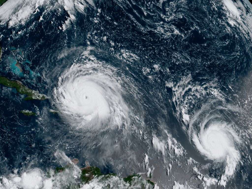 A satellite image from September 2017 shows Hurricane Irma, left, and Hurricane Jose, right, in the Atlantic Ocean. NOAA says the average annual number of tropical storms in the Atlantic has slightly increased.