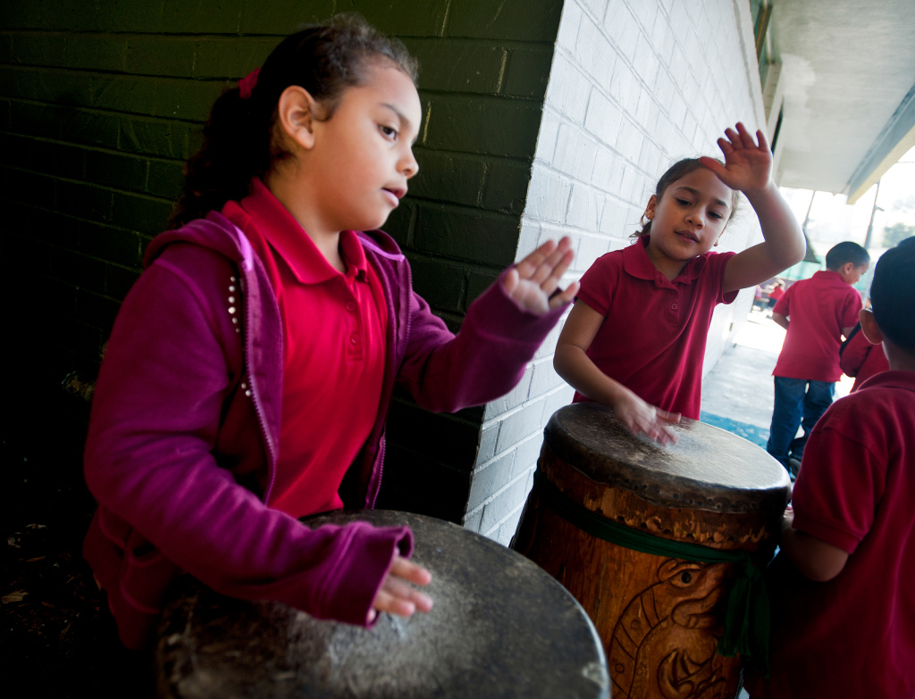 Kindergartener Zoe, right, plays the drums during recess at Academia Semillas del Pueblo on Dec. 5, 2012. The LAUSD charter school incorporates language and cultural learning and is part of Semillas Community Schools, which also includes the Anahuacalmecac International Preparatory High School.
