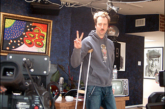 Tom Green in his home studio. He broke his leg doing a skateboard stunt.