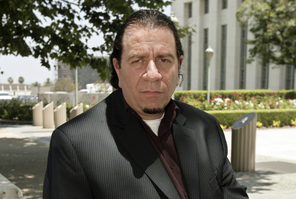 Ira Isaacs, who believes his work is an extreme but constitutionally protected form of art, poses outside the  Federal Courthouse Monday, June 9, 2008, in Los Angeles. A jury found Isaacs guilty of violating federal obscenity laws on April 27, 2012.