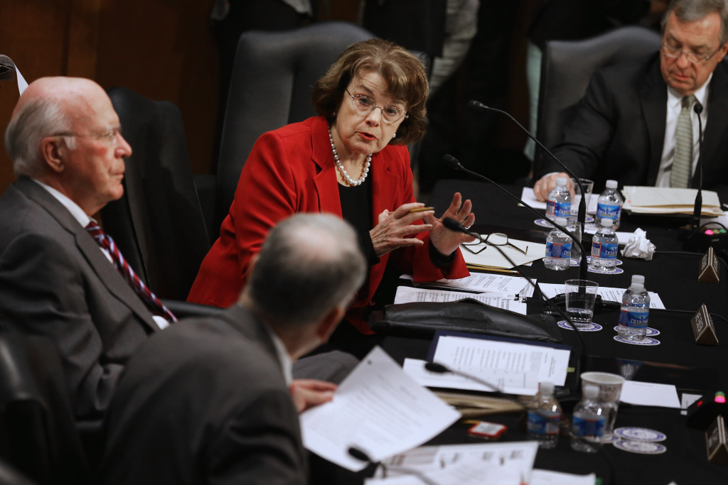 (L-R) Senate Judiciary Committee Chairman Patrick Leahy (D-VT), Sen. Charles Grassley (R-IA) (back to camera), Sen. Dianne Feinstein (D-CA) and Sen. Richard Durbin (D-IL) debate during a markup session for the bipartisan Senate immigration reform bill this week. Approved by the committee Tuesday, the bill now heads to the Senate floor.