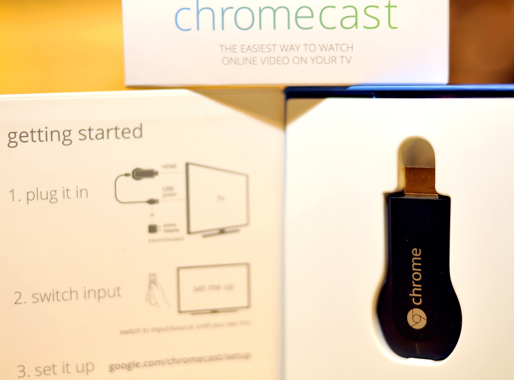 The new Google Chromecast is arranged on a table at a media event at Dogpatch Studios on July 24, 2013 in San Francisco, California. Google on Wednesday unveiled a slim, powerful new Nexus tablet computer and a thumb-drive sized device that lets popular mobile gadgets feed online content to television sets.