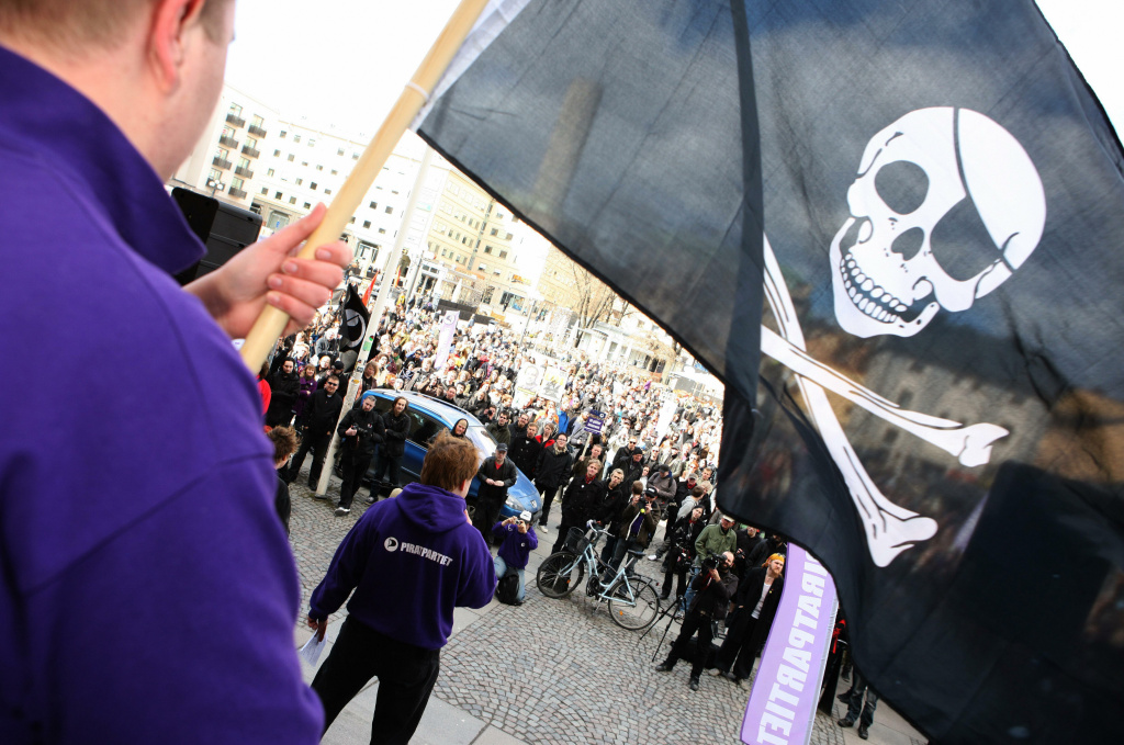 File photo taken on April 18, 2009 showing  supporters of the Pirate Bay website, one of the world's top illegal file sharing websites, demonstrating in Stockholm. According to several recent reports, content thieves profit by pulling in advertising from around the Internet, often concealing their illicit activities so advertising brands remain unaware.