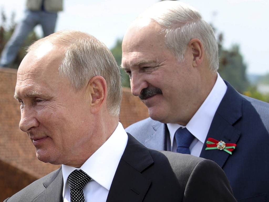 Russian President Vladimir Putin and Belarusian President Alexander Lukashenko greet a group of World War II veterans in the Russian village of Khoroshevo on June 30.