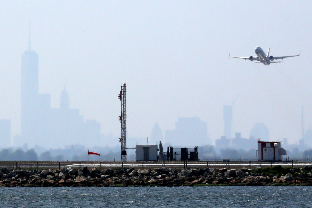 A plane takes off from New York's John F. Kennedy International Airport on May 25. Airports want Congress to raise passenger fees to pay for improvements.