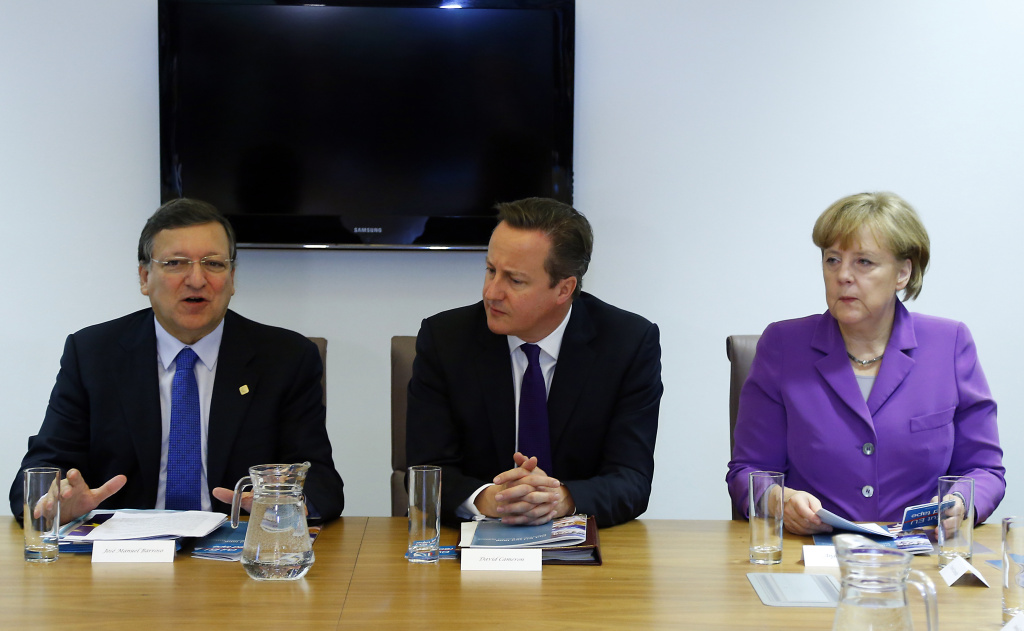 (From L) European Commission president Jose Manuel Barroso, Britsh Prime Minister David Cameron and German Chancellor Angela Merkel attend a meeting entitled 'Cut EU Red Tape' during the European Union Summit of Heads of States held at the European Union Council building in Brussels on October 25, 2013.