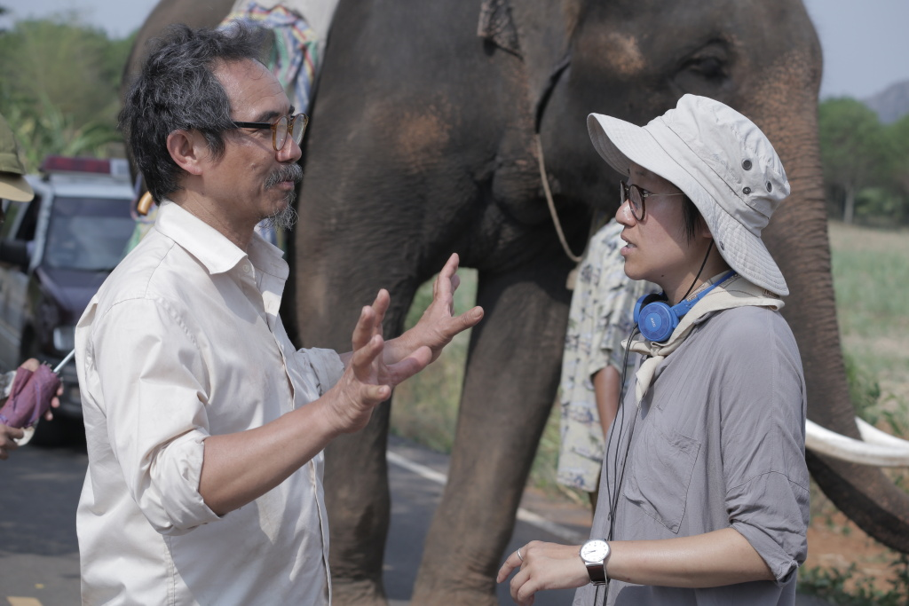 Actor Thaneth Warakulnukroh (left) and writer-director Kirsten Tan with Bong the elephant on the set of