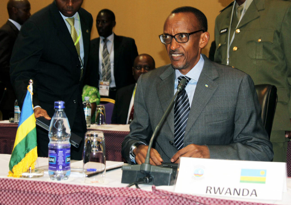 Rwanda's President Paul Kagame listens to proceedings during the International Conference of the Great Lakes Region (ICGLR) in Kampala on October 8, 2012. The Presidents and representatives of the Great Lakes Countries are meeting in Kampala to discuss the security situation in Eastern Democratic Republic of Congo (DRC).
