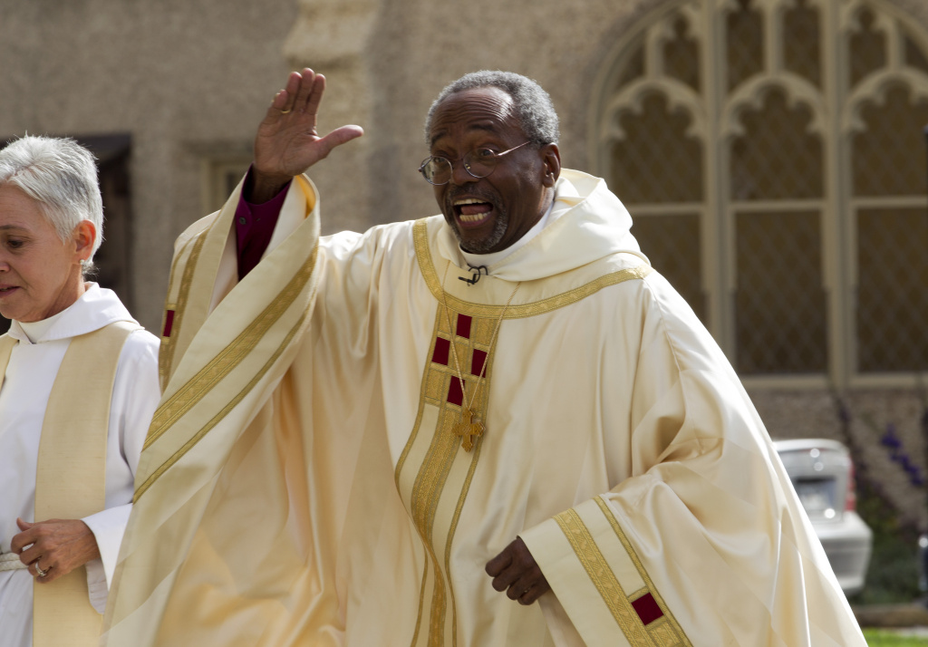 Episcopal Church Presiding Bishop-elect Michael Curry waves to the crowd as he arrives at the Washington National Cathedral, Sunday, Nov. 1, 2015, in Washington, D.C. Curry, who comes to the job after nearly 15 years leading the Diocese of North Carolina, was elected last summer to succeed Presiding Bishop Katharine Jefferts Schori, the first woman leader of the church.