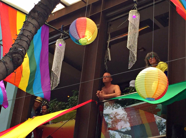 Sister Leiya watches the 2016 Gay Pride Parade in West Hollywood, California on June 12, 2016. Security for the tightened in the aftermath of the deadly shootings June 12 at the Pulse, a packed gay nightclub in Orlando, Florida.