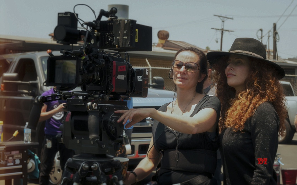 Director Alma Har'el (R) on the set of