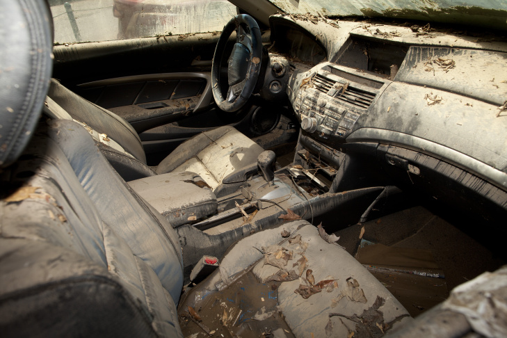 The interior of a vehicle trapped in a UCLA parking garage is filled with mud and debris after a broken water main flooded parts of campus.
