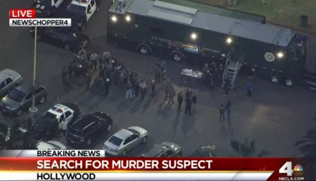 Screenshot from NBC L.A. showing police amid Hollywood Hills search on Tuesday, Feb. 4, 2014.