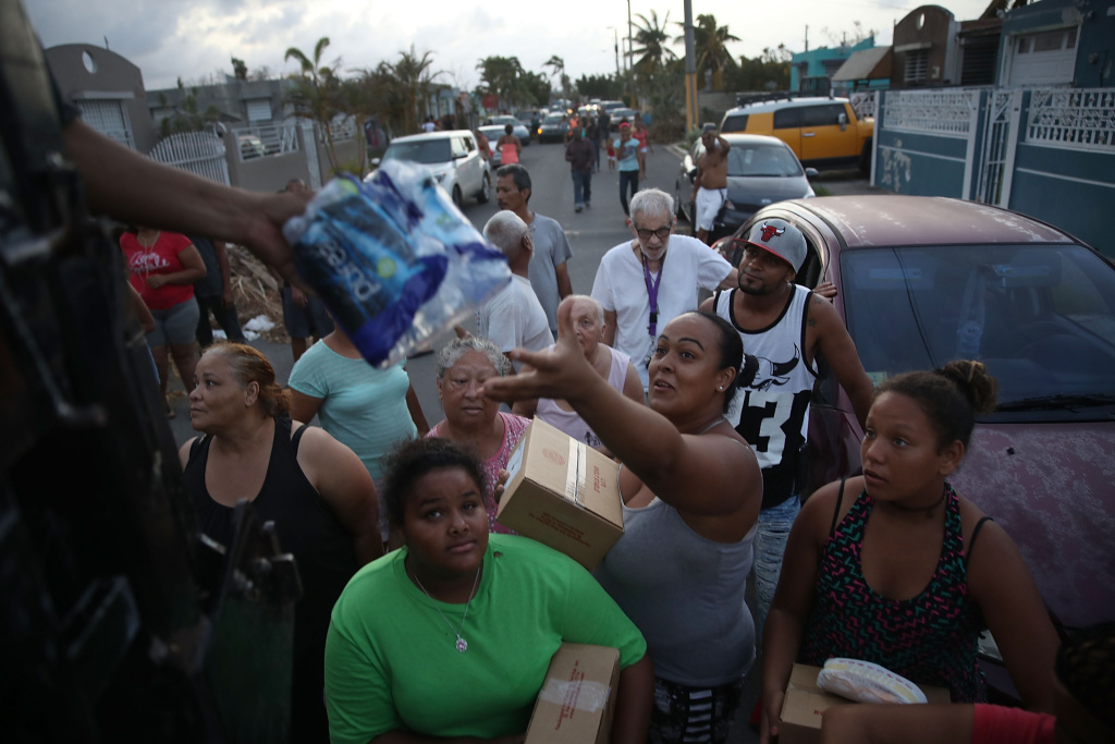 Donald Trump threw paper towels like a basketball to Puerto Ricans
