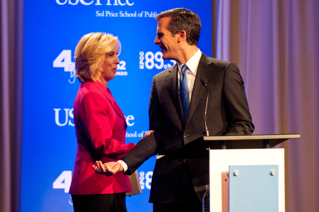 Eric Garcetti and Wendy Greuel, seen here before a recent mayoral debate, are in the homestretch before the May 21 runoff. He continues to lead in a USC/L.A. Times poll.