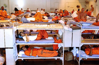 California prisoners in a crowded gymnasium.