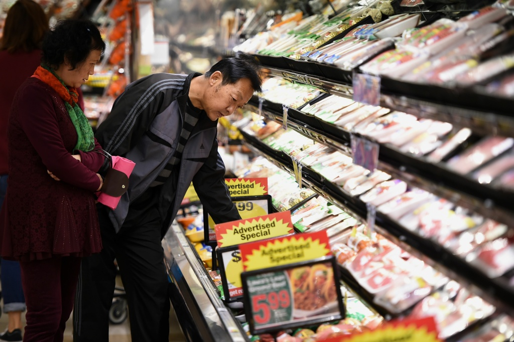 Shoppers look at meat for sale, November 28, 2016 at a Ralph's Supermarket in Irvine, California.