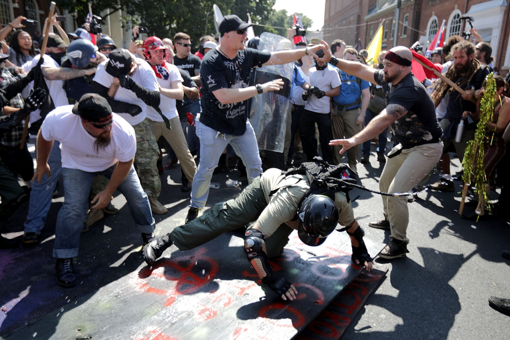 CHARLOTTESVILLE, VA - AUGUST 12:  White nationalists, neo-Nazis and members of the