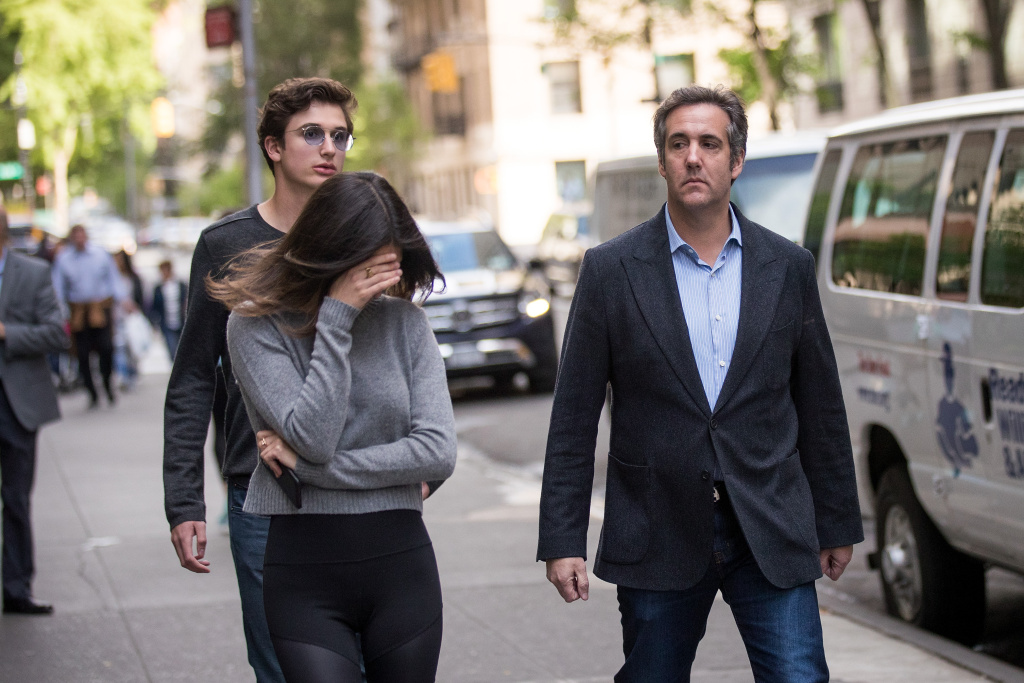 Michael Cohen, former personal attorney for U.S. President Donald Trump, walks with his children as he exits the Loews Regency Hotel in New York City on May 11, 2018.
