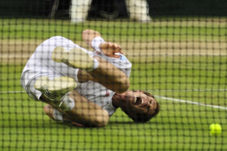 Britain's Andy Murray hits the ground af