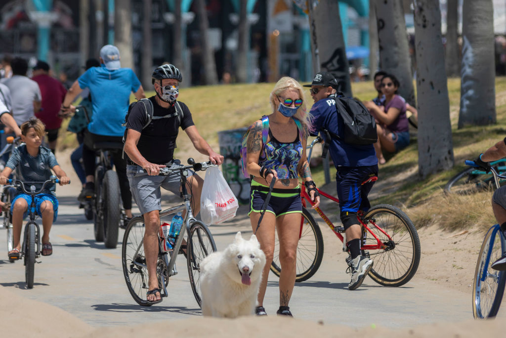 Holiday beachgoers head to Venice Beach on Memorial Day as coronavirus safety restrictions continue being relaxed in Los Angeles County and nationwide on May 24, 2020 in Los Angeles, California.