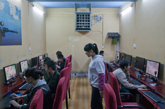 Patrons gather to use computers at an Internet cafe in Kunming, southwest China's Yunnan province on April 1, 2010.