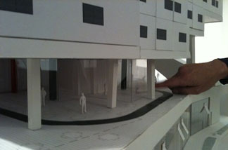 Silver Lake architect Michael Maltzan shows the scale of a model for a new sustainable building.