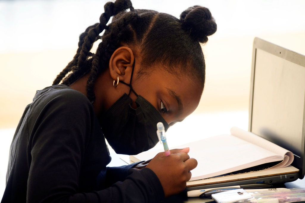 A child attends an online class at a learning hub inside the Crenshaw Family YMCA during the Covid-19 pandemic on February 17, 2021 in Los Angeles, California.