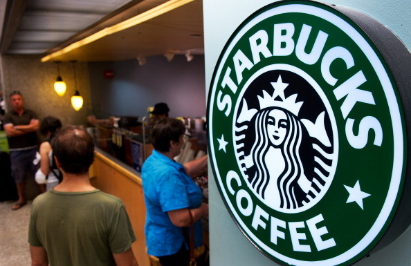 Customers queue for coffee at Starbucks