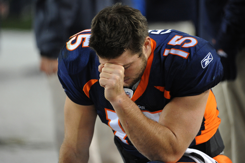 DENVER, CO - NOVEMBER 17: Tim Tebow #15 of the Denver Broncos prays during the final minute of the game against the New York Jets at Sports Authority Field at Mile High on November 17, 2011 in Denver, Colorado.  (Photo by Garrett W. Ellwood/Getty Images)