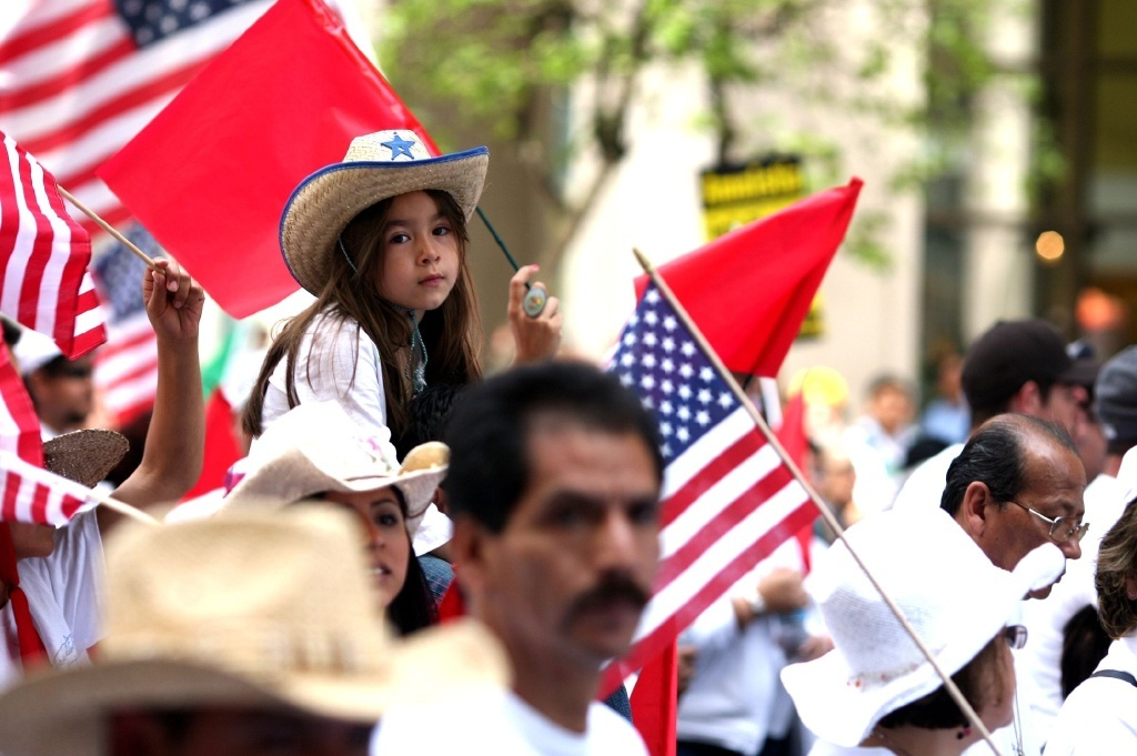 File photo of a crowd waving American flags.