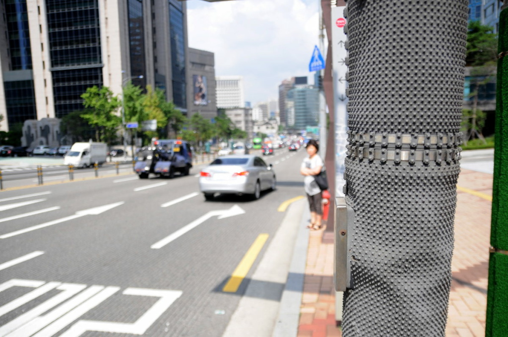Here is an example of a textured pole in Seoul, South Korea. The texture prevents stickers and other items from being attached.
