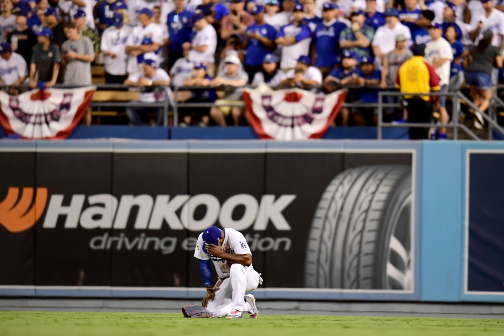 Yasiel Puig of the Los Angeles Dodgers reacts after he was unable to catch a ground rule double hit by Alex Bregman of the Houston Astros (not pictured) during the eighth inning in game two of the 2017 World Series at Dodger Stadium on Oct. 25, 2017 in Los Angeles, California.